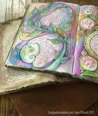 Some more spiritually-themed journals with colorful watercolor pages...