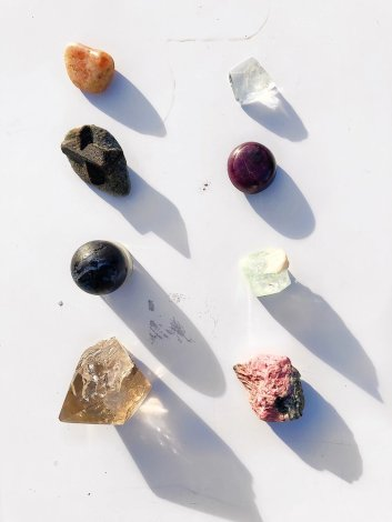 Left row: Winter Solstice crystals (from top: sunstone, staurolyte, merlinite, smoky quartz)  Right row: Summer Solstice crystals (from top: white topaz, ruby, green apophyllite, rhodonite)